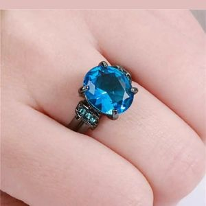 Oval blue aquamarine black rhodium plated S6